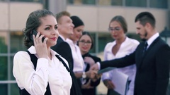 Young smiling business woman discussing her successful working day on the phone Stock Footage