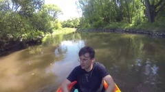 Man (with model release) sails on inflatable boat Intex Stock Footage
