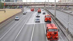 Watering trucks on highway Leningradsky Prospect in Moscow Stock Footage