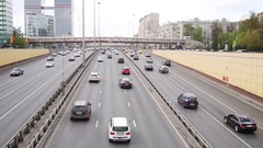 Lot of cars go on modern highway in city at day, text on truck - concrete Stock Footage
