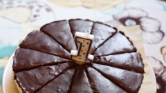 Homemade chocolate cake with candle 1, close up, shallow dof Stock Footage