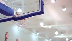 Attempt to shoot ball in ring during basketball game indoor Stock Footage