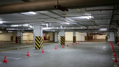 Empty underground car parking in which light is switched on and off Stock Footage