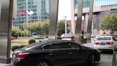 Cars and people near hotel, Shanghai has population of 24,6 millions people Stock Footage