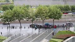 People go on wet street after rain in city, top view Stock Footage