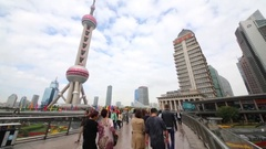 Tourists near TV tower Oriental Pearl, this tower is third highest in Asia Stock Footage