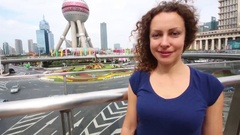 Woman and TV tower Oriental Pearl, This tower is third highest in Asia Stock Footage