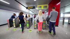 Passage through turnstile in Shanghai subway in Shanghai, China Stock Footage