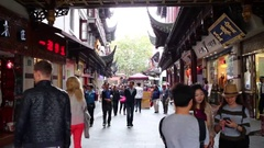 Tourists make selfie bear stylish shops in Shanghai, China Stock Footage