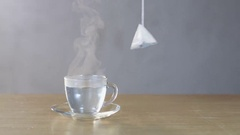 Man Puts a Teabag Into a Cup Stock Footage