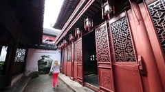 Blond woman walks in yard of Yuyuan Garden, Shanghai, China Stock Footage
