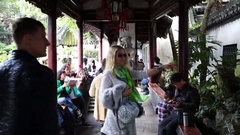 Tourists in Yuyuan Garden (three people with model releases) in Shanghai, China Stock Footage