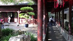 Tourists in sunny Yuyuan Garden, Today occupies an area of 2 hectares Stock Footage
