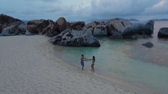 Aerial view of a honeymoon couple dancing on the beach in Virgin Gorda Stock Footage