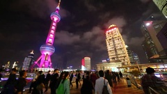 TV tower Oriental Pearl and tourists at night in Shanghai, China Stock Footage