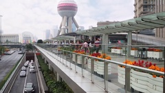 Road, walking people, part of TV tower, Shanghai - commercial center of China Stock Footage
