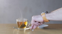 Man Taking Teabag out of a Cup Stock Footage