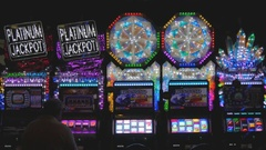 Man playing slot machine in casino in Las Vegas, Nevada Stock Footage