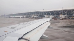 Wing of aircraft in plane landed at airport in Shanghai, China Stock Footage