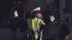Female police officer directing car traffic at New York street, USA Stock Footage