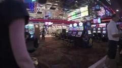 Walking through slot machines in casino in Las Vegas, steadicam shot Stock Footage