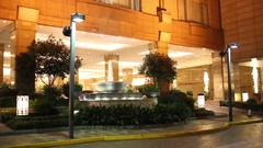 Modern beautiful fountain near building at summer night Stock Footage