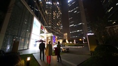 People go to hotel at night, Shanghai has population of 24,6 millions people Stock Footage