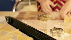 Christmas preparation: a boy makes different forms of gingerbread cookies Stock Footage