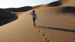 Walk and footprints on the sand dunes Stock Footage