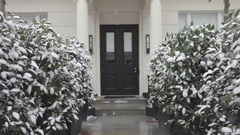 Victorian House Door With Snow Weather in London Stock Footage