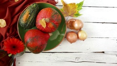 Autumnal still life getting the last stroke from a designer - a golden onion Stock Footage