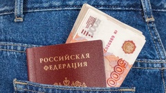 Russian rouble bills and passport in the back jeans pocket Stock Footage