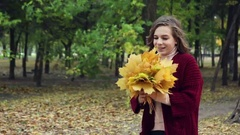 The brunette in a red poncho enjoying the autumn wind Stock Footage
