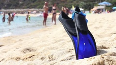 Summer Beach swimming accessories ,fins and goggles on the sand beach. Stock Footage