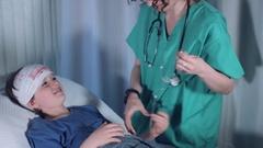 4k Hospital Shot of Injured Child Finishing Treatment, Doctor Removes Bandage Stock Footage