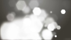 Falling white particles on gray background Stock Footage