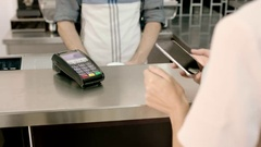 Business woman paying contactless in cafe Stock Footage