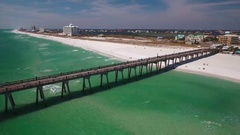 Fishing Pier on a white sandy beach Stock Footage