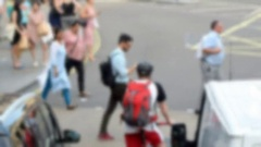 Blurred view of city traffic with people and bike Stock Footage