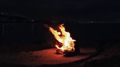 Burning boots on the sand at coast Stock Footage