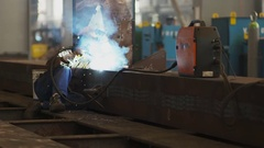 Arc-welding large steel construction in production hall Stock Footage