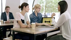Women Working Together on presentation Stock Footage
