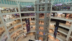 Timelapse of customers walking in Suria KLCC shopping mall Stock Footage