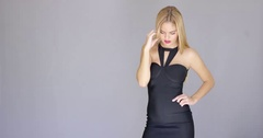 Curvaceous sexy young woman posing in elegant dress Stock Footage