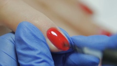Manicurist gets a top coating on the nail Stock Footage