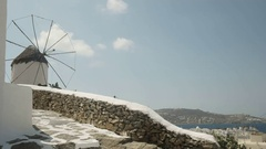 Pan shot of an old windmill above chora on mykonos Stock Footage