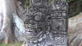 4k Balinese stone sculpture temple-watcher close up portrait panning 4k or 4k+ Resolution