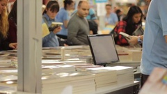 Browse books at the fair Stock Footage