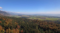 4K Cinematic forest aerial shot - panning around a lovely autumn landscape Stock Footage