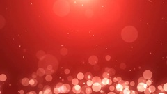Soft red background with glowing golden and white particles Stock Footage